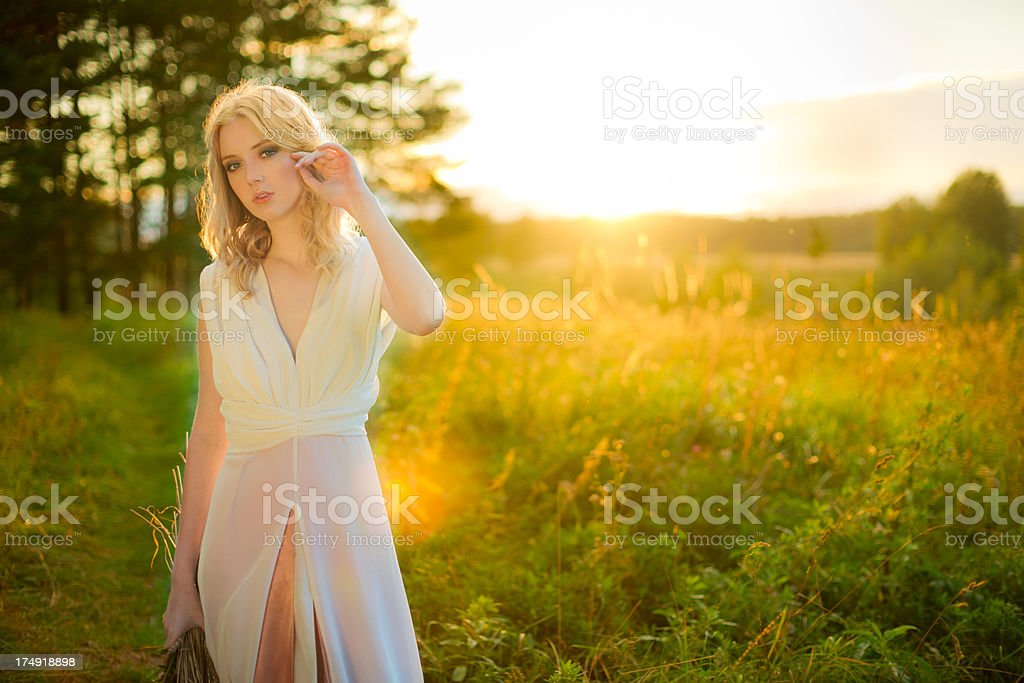 Young woman in the light of evening sun royalty-free stock photo