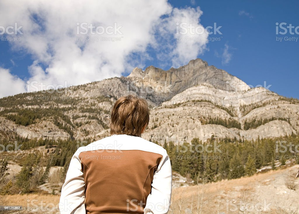 Young woman in the mountains. royalty-free stock photo