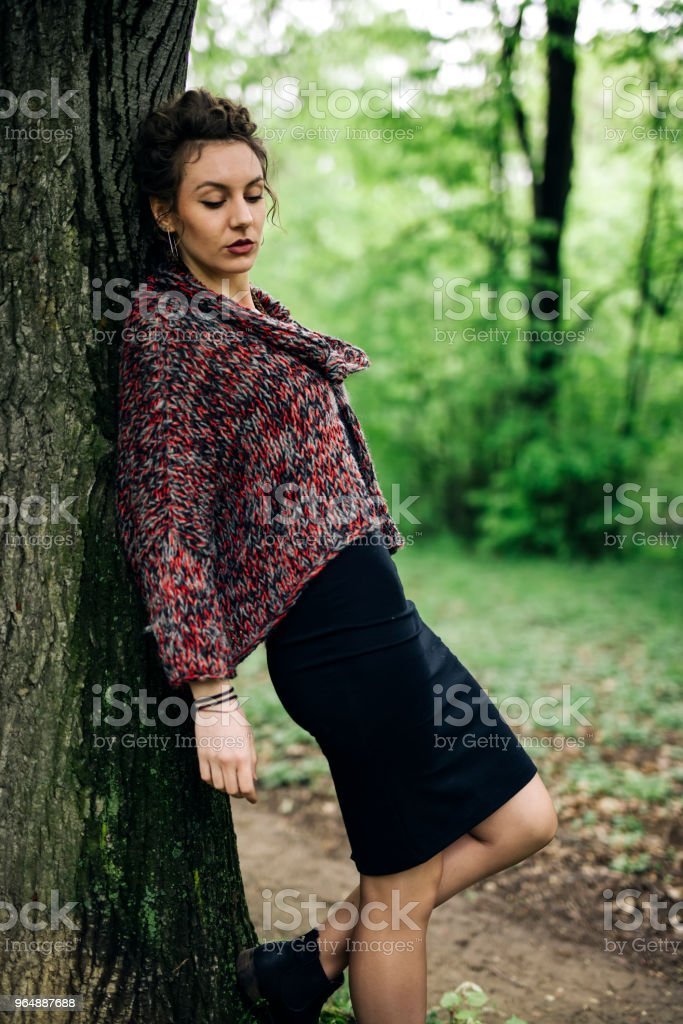 Young woman in the park by tree royalty-free stock photo