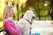 istock Young Woman in the Park With Dog 672895554