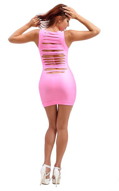 junge frau im rosa kleid - enge kleider stock-fotos und bilder