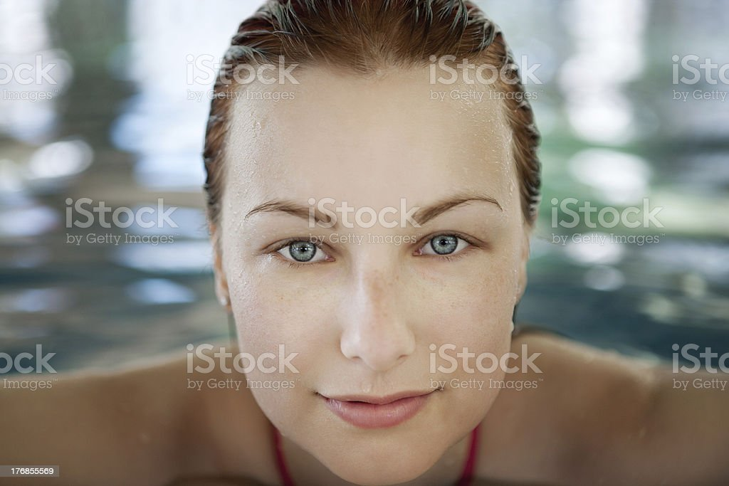 Young woman in the pool royalty-free stock photo