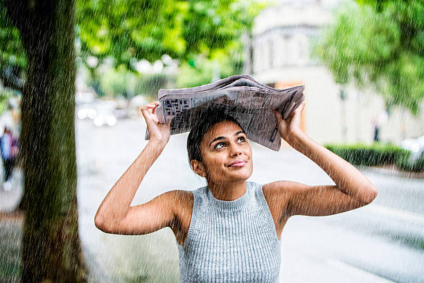 young woman in the rain. - drenched stock pictures, royalty-free photos & images