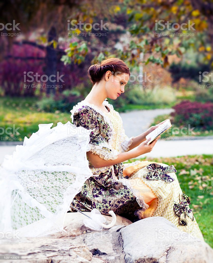 Young woman in the rays of autumn sun royalty-free stock photo