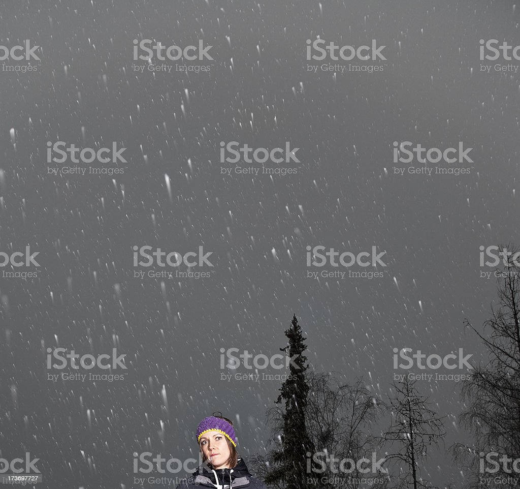 young woman in the snowfall royalty-free stock photo