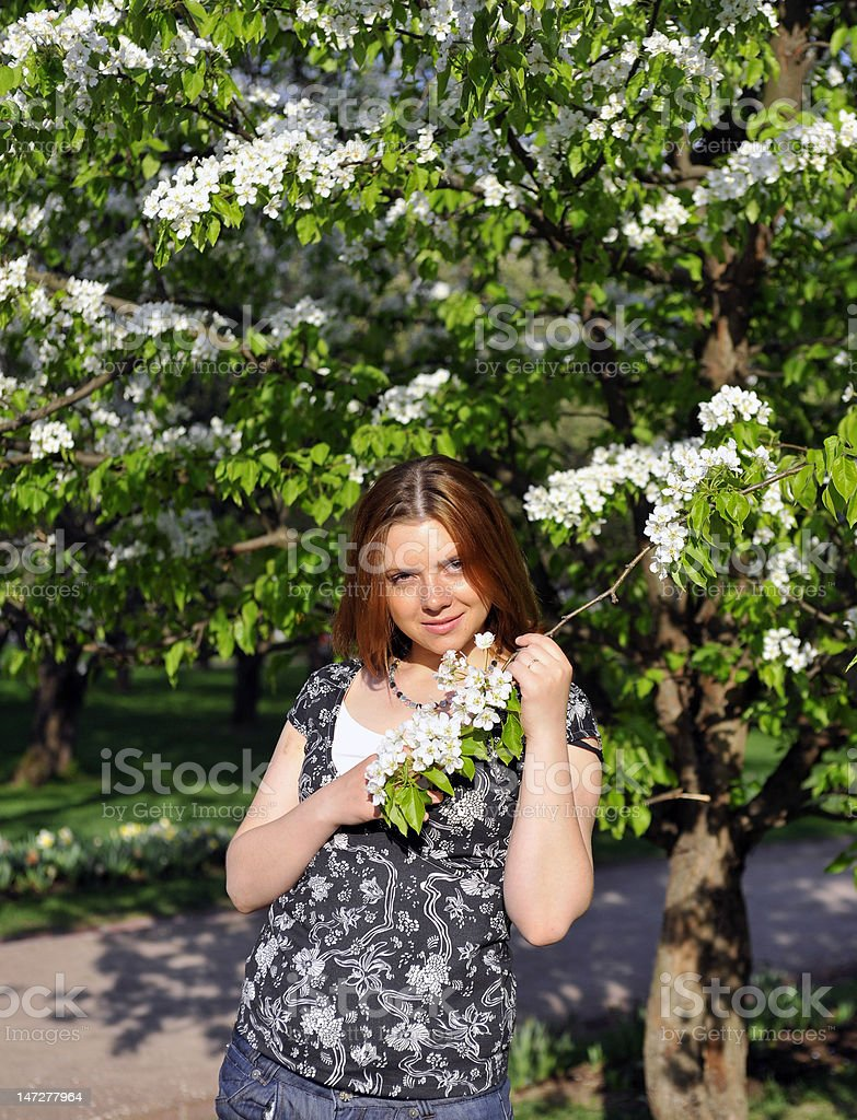 young woman in the spring garden royalty-free stock photo