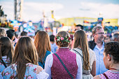 Munich, Germany - September 29, 2016: rear view on young woman in dirndls  in the crowd at Oktoberfest in Munich