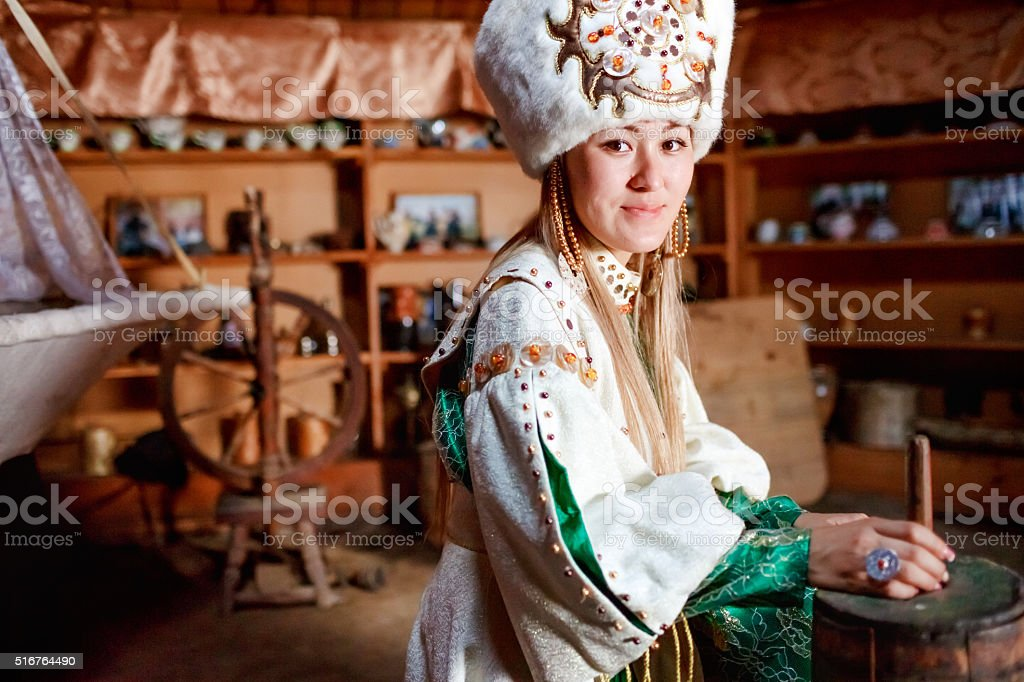 Young woman in traditional yurt dwelling stock photo