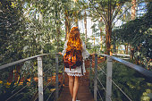 Young woman in tropical environment