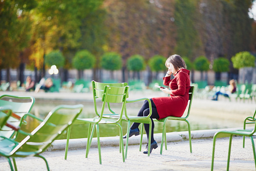 Young woman in Tuileries garden of Paris, France