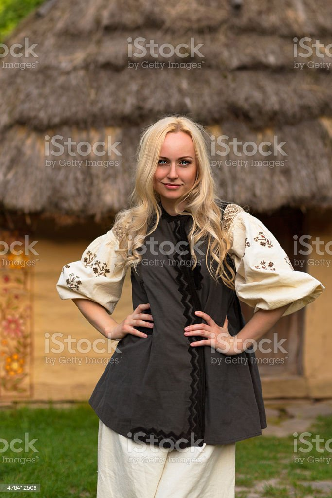 Young woman in ukrainian national costume - smiling stock photo