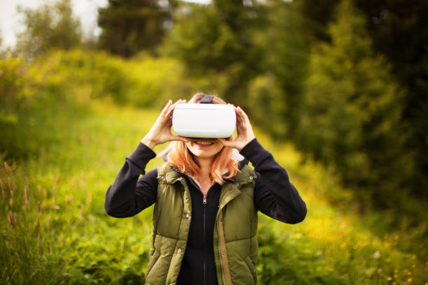 Young woman in virtual reality headsets Young woman in virtual reality headsets augmented reality sustainable stock pictures, royalty-free photos & images