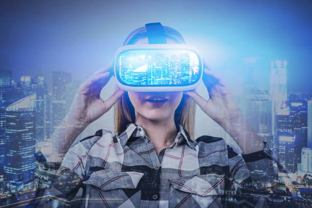 Young woman in VR glasses in virtual city stock photo