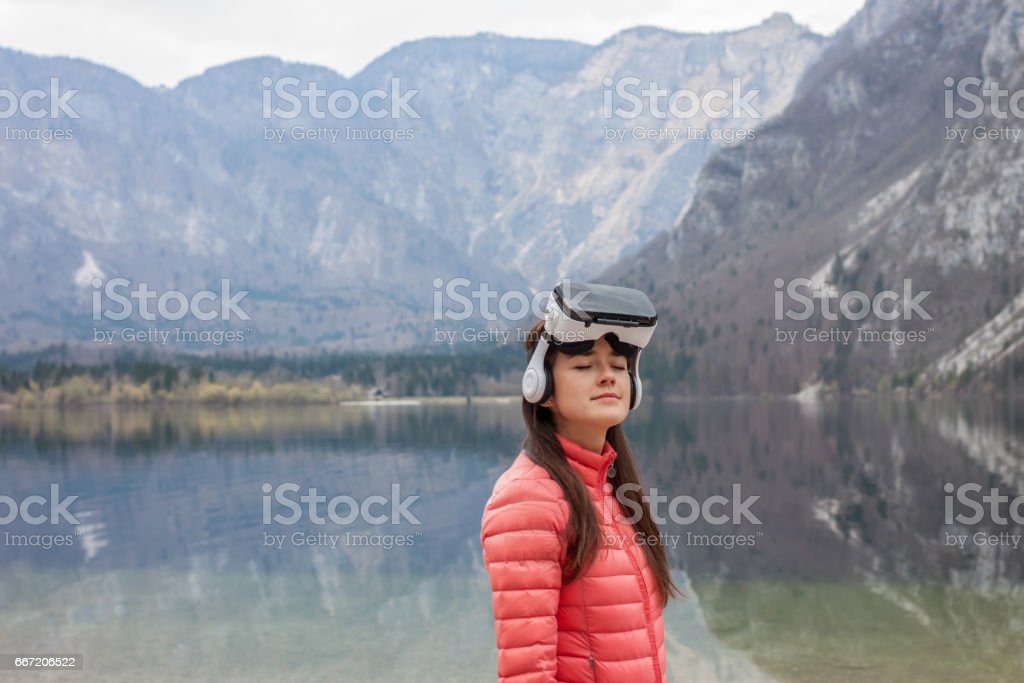 young woman in VR glasses royalty-free stock photo