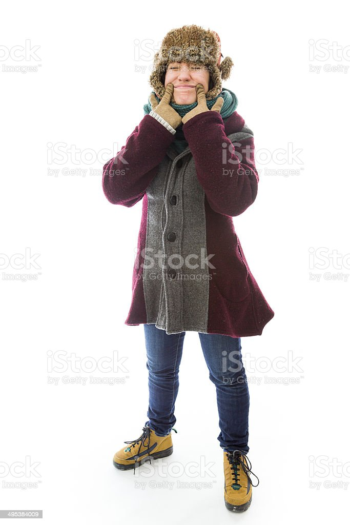 Young woman in warm clothing and showing smiley face royalty-free stock photo