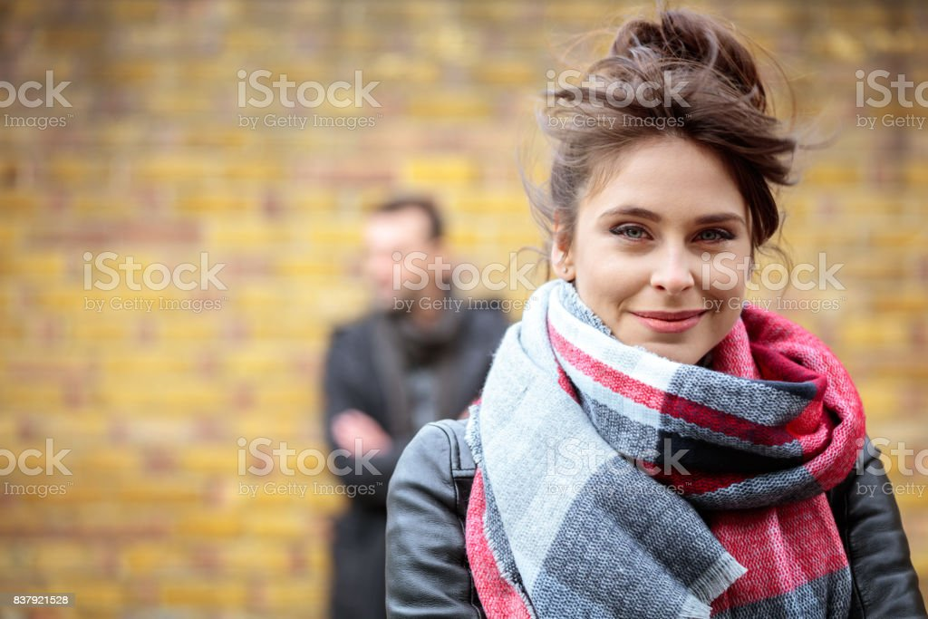 Young woman in warm clothing outdoors stock photo