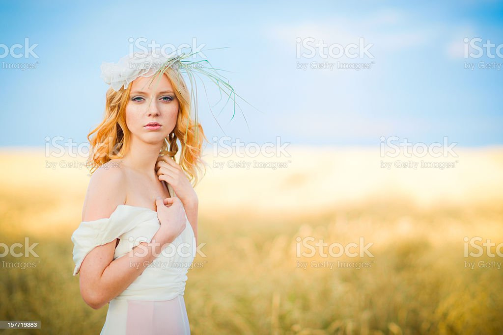 Young woman in wheat field royalty-free stock photo