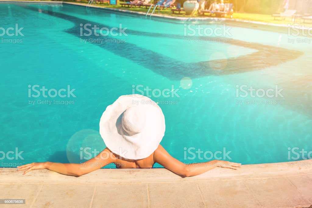 young woman in white hat stock photo