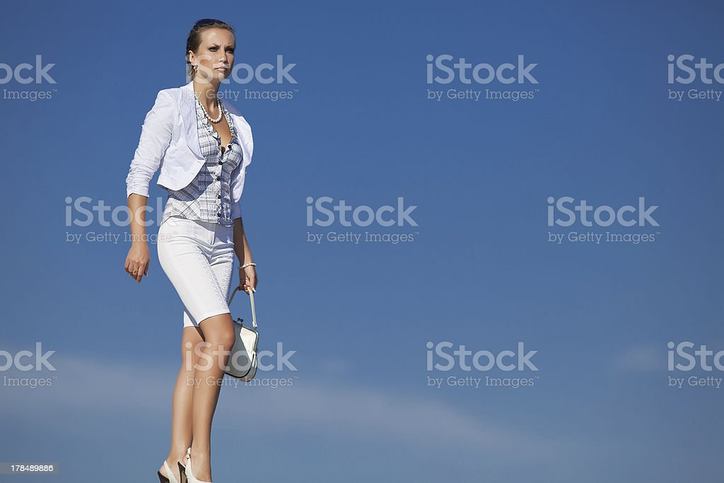 Young woman in white outdoors stock photo