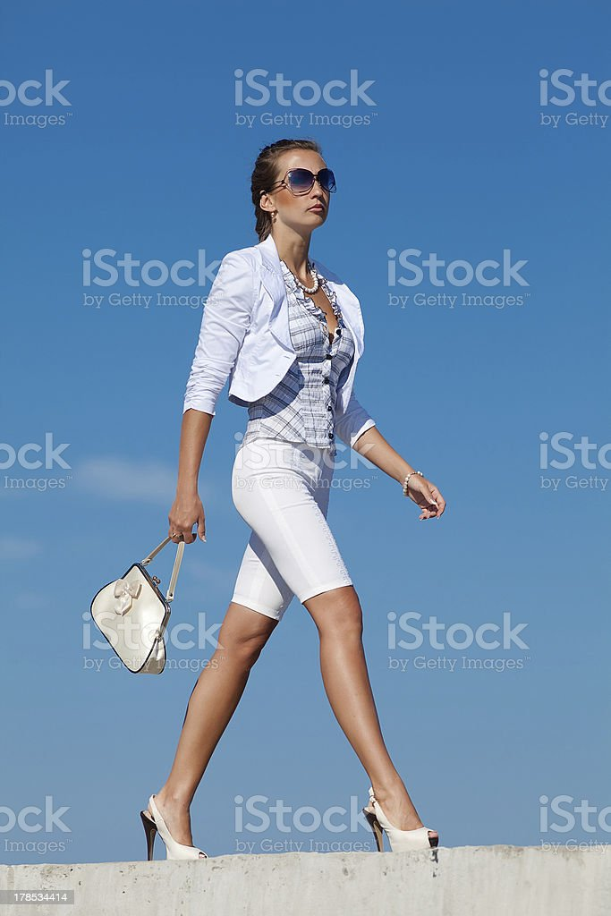 Young woman in white outdoors royalty-free stock photo
