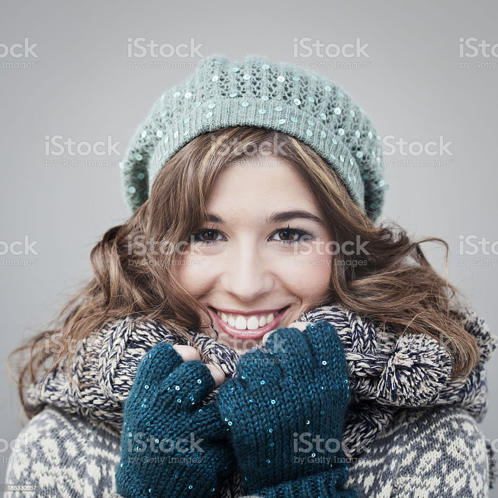 Young woman in winter attire, cap scarf and gloves. royalty-free stock photo