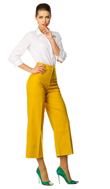 Young woman in yellow pants isolated stock photo