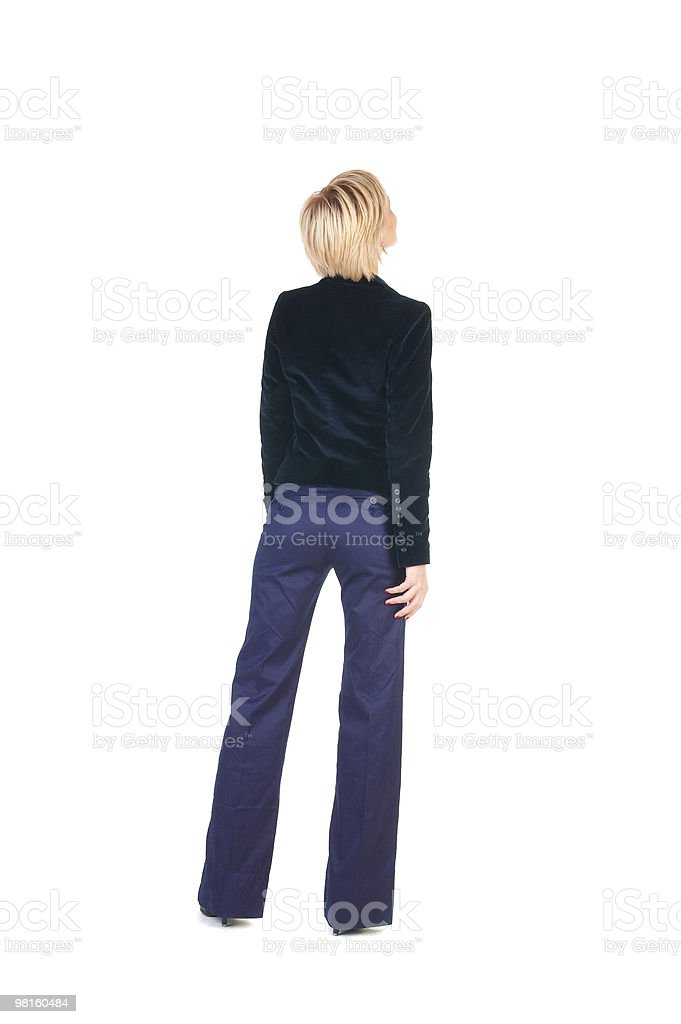 Young woman in yellow suit looking at wall. royalty-free stock photo