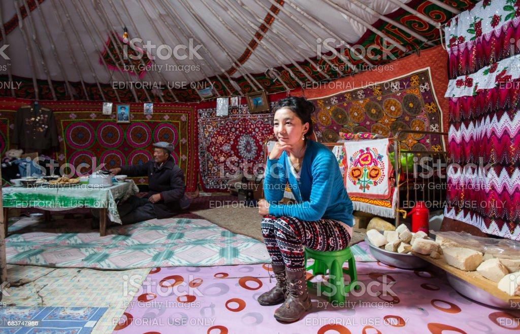 Young woman inside her home ger (mongolian yurt) stock photo