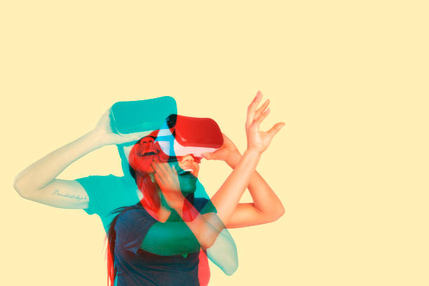 young woman inside virtual reality - augmented reality stock photos and pictures