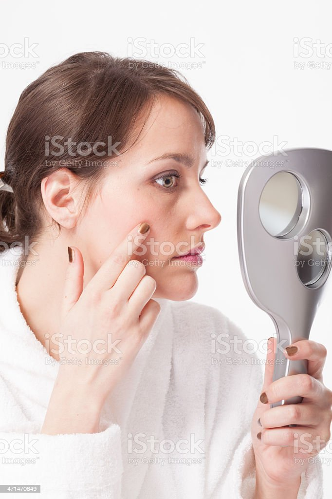 Young woman inspecting her skin stock photo