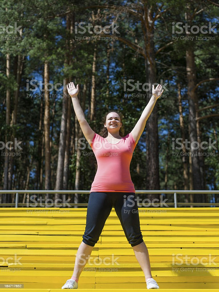 Young woman is a fan of the team royalty-free stock photo
