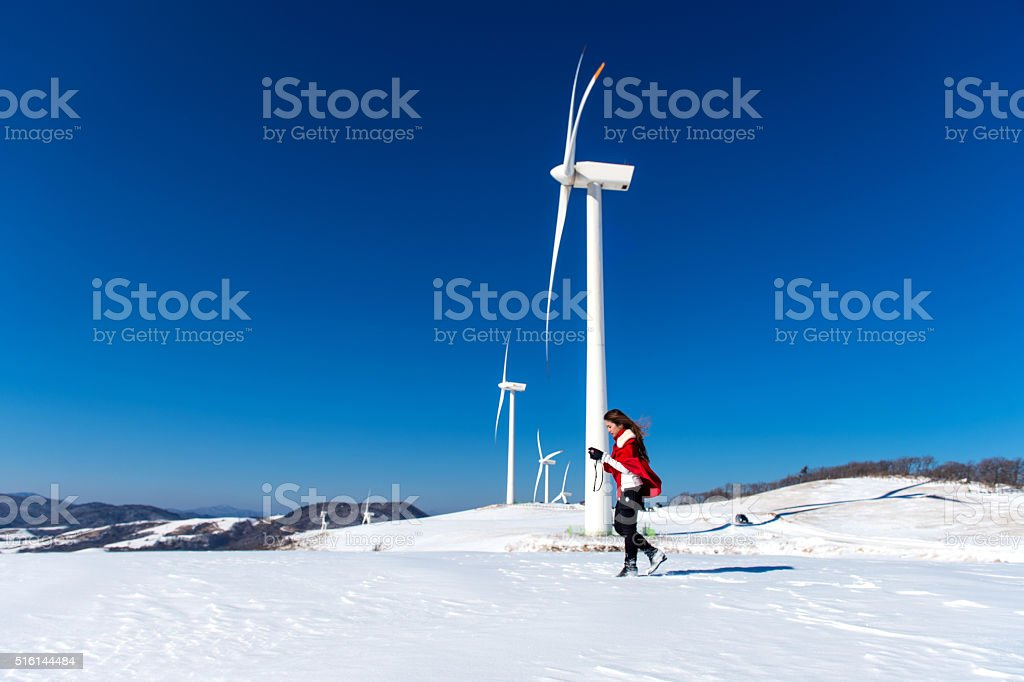 Young woman is a happiness with camera in winter stock photo