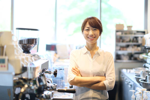 A young woman is an owner of the cafes. stock photo