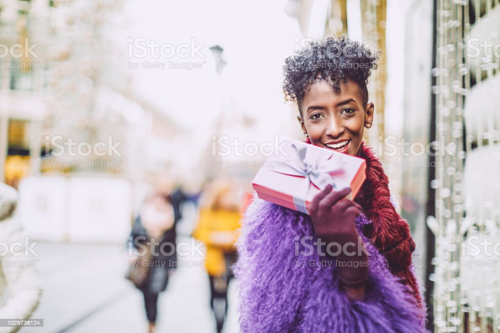 Young woman is buying Christmas presents