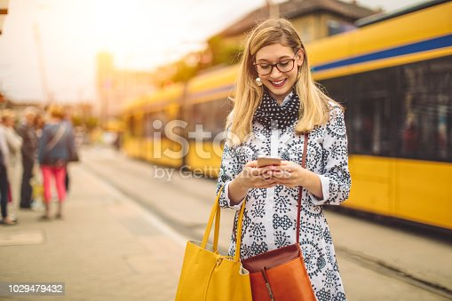 Young woman is checking her messages