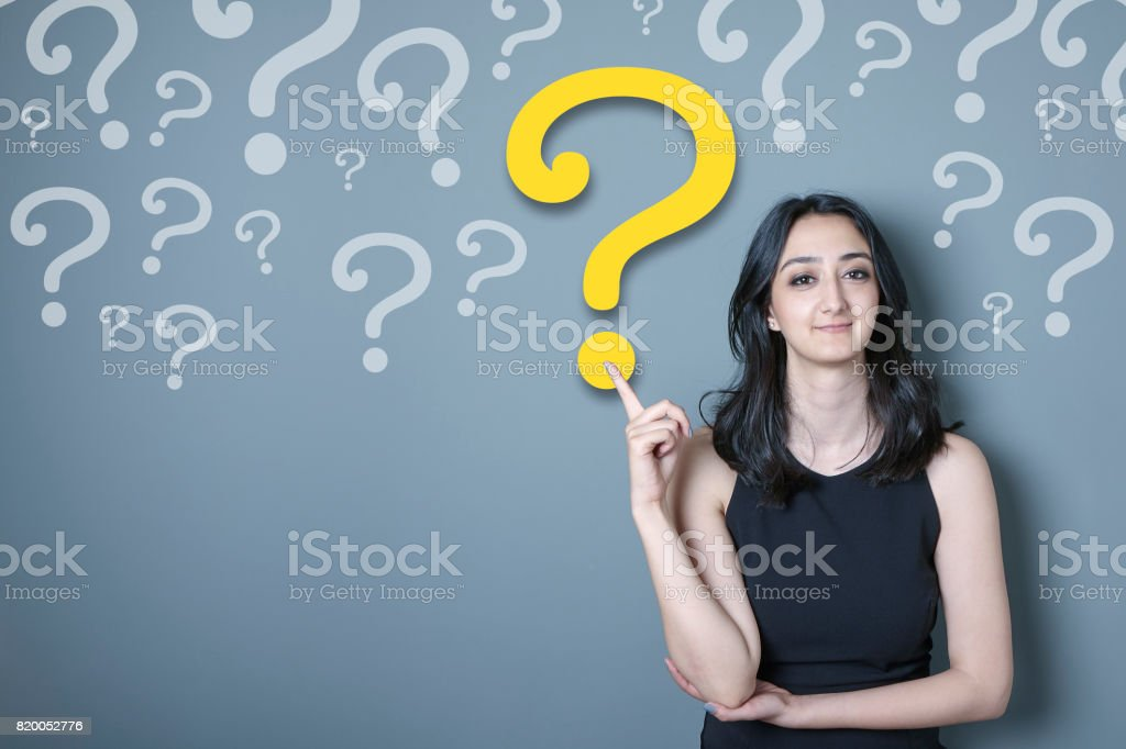 Young woman is chosing a question between many others stock photo