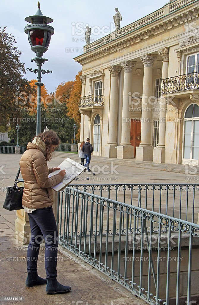 young woman is drawing building of Lazienki Palace in Warsaw stock photo