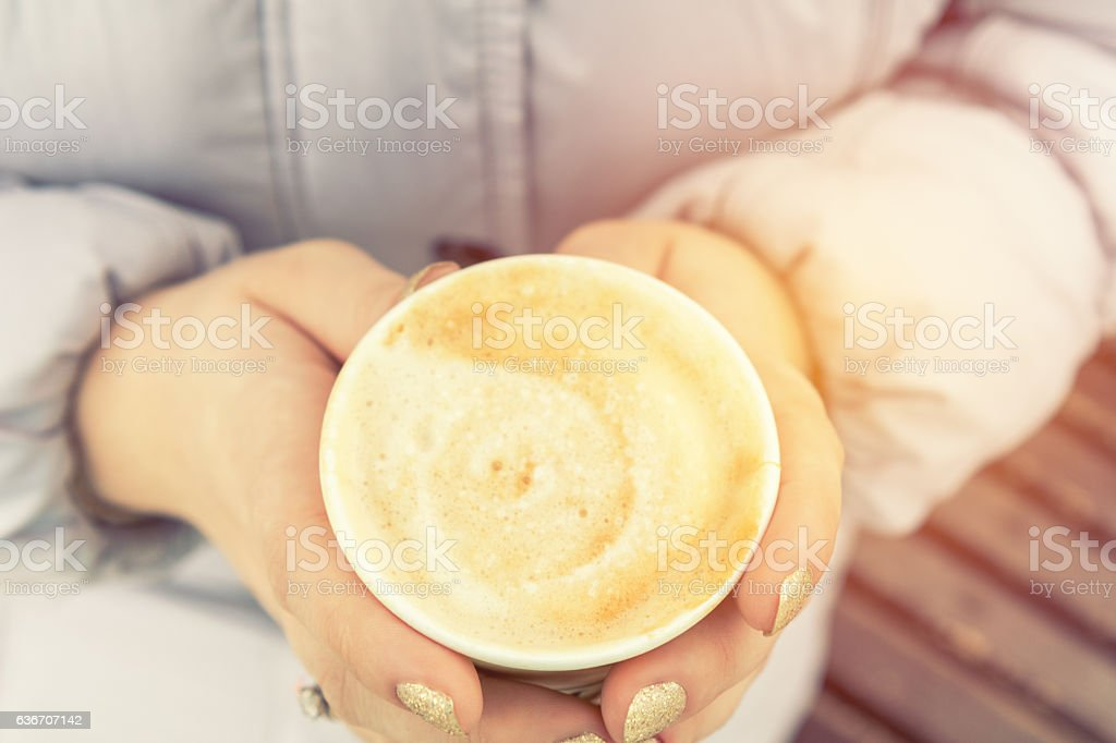 Young woman is drinking coffee on the street royalty-free stock photo