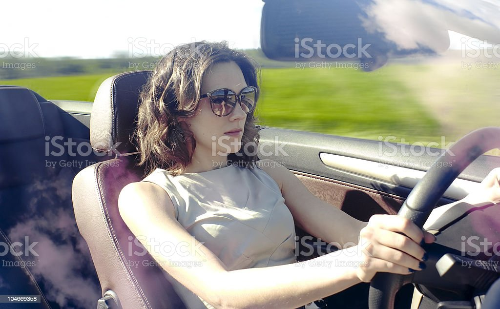 Young woman is driving royalty-free stock photo