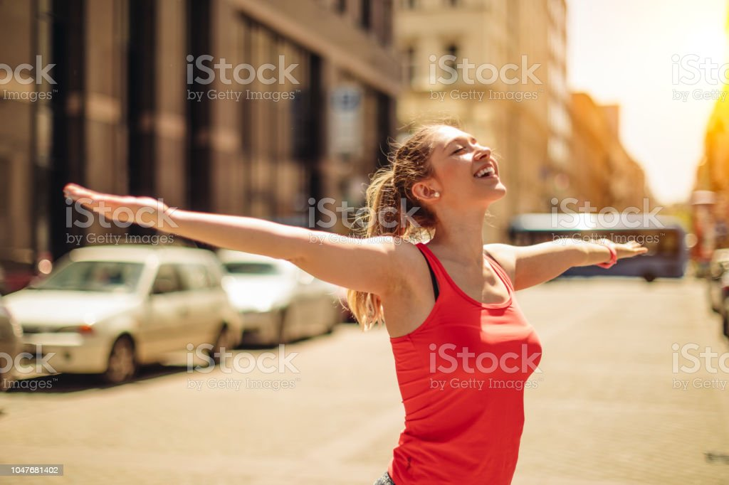Young woman is enjoying the exercise in the city