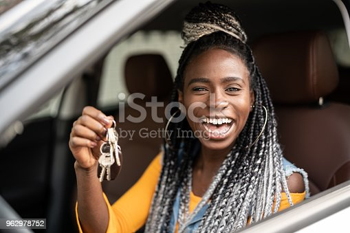 istock Young woman is excited about new car 962978752