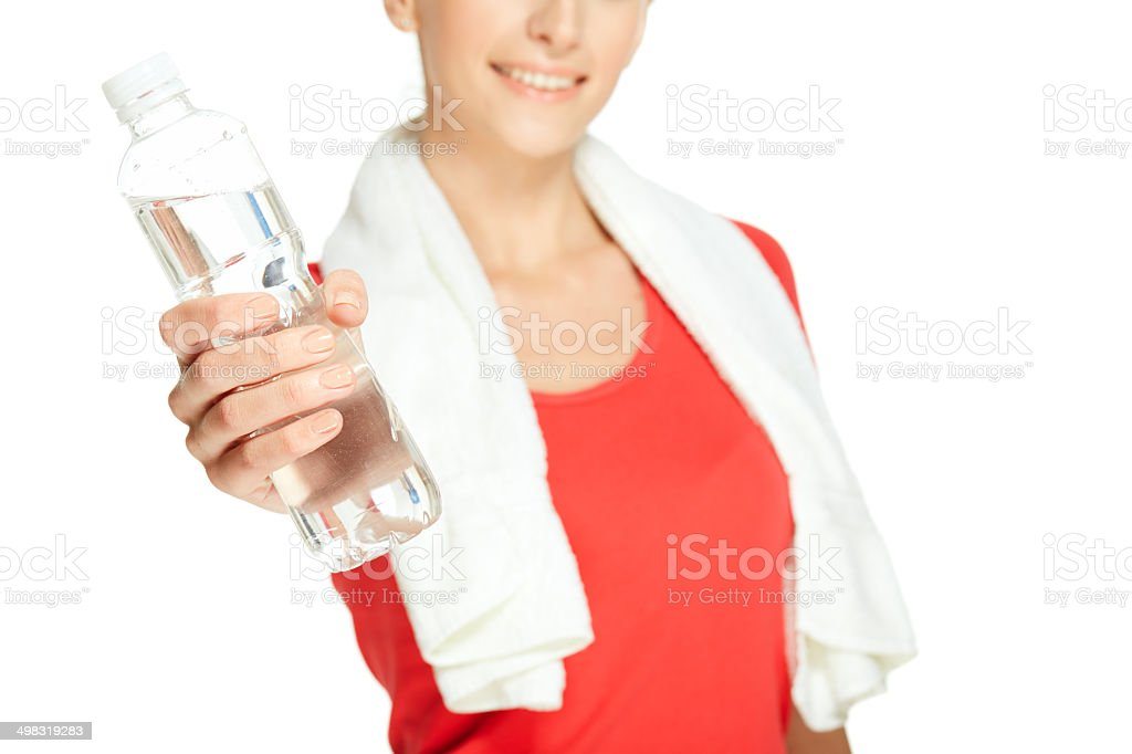 Young woman is handing the  bottle stock photo