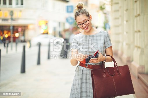 Young woman is having fun in the city - autumn mood