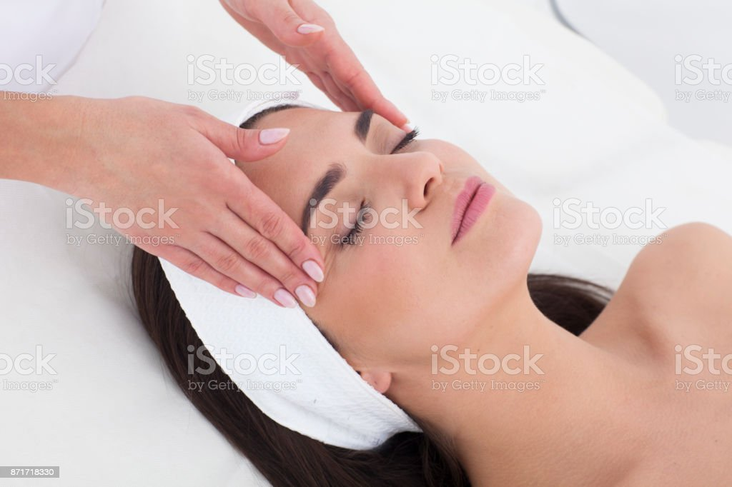 Young woman is having massage. stock photo
