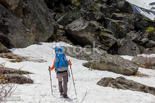 istock Young woman is hiking in highlands of Altai mountains, Russia 618857034