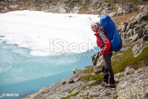 istock Young woman is hiking in highlands of Altai mountains, Russia 618858706