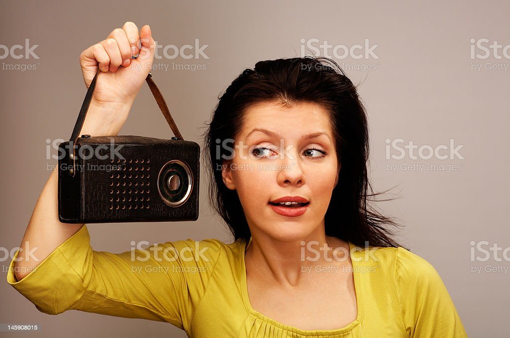 young woman is listening radio stock photo