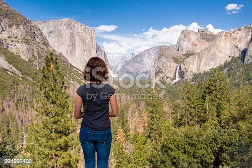 Young woman is looking at Yosemite valley from Tunnel View in Yosemite National park, United states of America