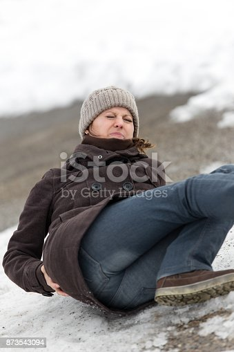 istock young woman is lying on a ice way 873543094