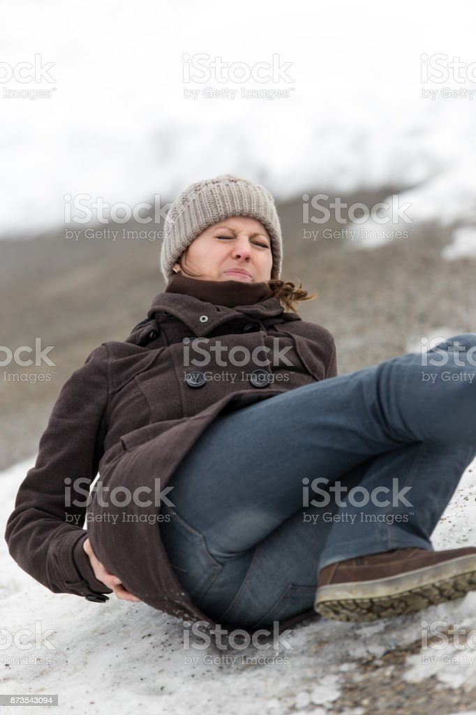 young woman is lying on a ice way stock photo